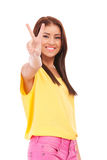 Young smiling woman with victory gesture Stock Photo