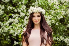 Young smiling woman wearing flowers wreath. Stock Photo