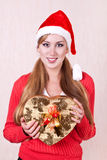 Young smiling woman wearing Santa Claus hat Royalty Free Stock Photography