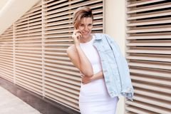 Young smiling woman speaks by phone Stock Images