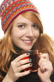 Young smiling woman with winter cap warming-up wit. H tea on white background Stock Images