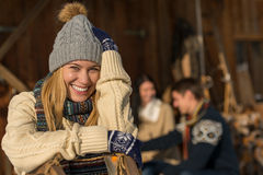 Young smiling woman in winter clothes cottage Stock Image