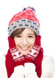 Young smiling woman in winter clothes and touching face Royalty Free Stock Photography