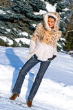 Young smiling woman in winter forest royalty free stock image