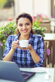 Young smiling woman woking on computer outdoors Stock Images