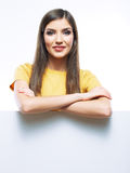 Young smiling woman yellow dressed show blank card Stock Photography
