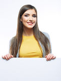 Young smiling woman yellow dressed show blank card. Royalty Free Stock Images