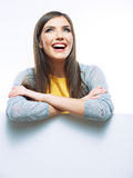 Young smiling woman yellow dressed show blank card Royalty Free Stock Images
