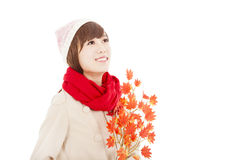 Young smiling woman with yellow maple leaf Stock Photos