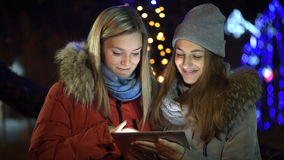 Young smiling women having enjoyable time with tab. Friends using a digital tab stock footage
