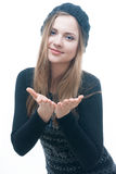 Young smilling girl in black dress and beret stock photography