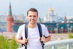 Young man hiking smiling happy portrait. Male hiker walking in the city. Young smilling man hiking smiling happy portrait. Male hiker walking in the city. Young Royalty Free Stock Photo
