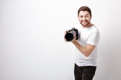 Young smilling professional photographer in t-shirt use digital Stock Photo