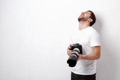 Young smilling professional photographer in t-shirt use digital Stock Photography