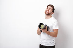 Young smilling professional photographer in t-shirt use digital Stock Photos