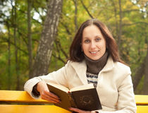Young smilling woman with book Royalty Free Stock Photos