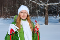 Young smilling woman in winter forest Royalty Free Stock Photos