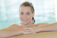 Young smling girl swimming in swimming pool Stock Photography