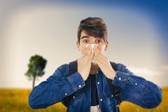 Young sneezing with handkerchief stock images