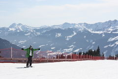 Young snowboard man sliding downhill. Royalty Free Stock Images