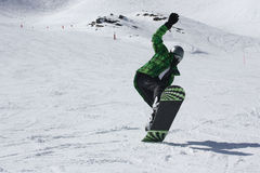 Young snowboard man sliding downhill. Royalty Free Stock Image