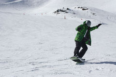 Young snowboard man sliding downhill. Stock Photography
