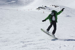 Young snowboard man sliding downhill. Stock Photos