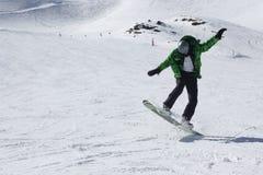 Young snowboard man sliding downhill. Stock Photos