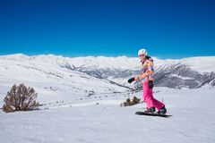 Young snowboard woman in pink Royalty Free Stock Image
