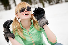 Young snowboarder reaches his arms Stock Photography
