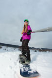 Young snowboarder shooting a selfie by her action camera Royalty Free Stock Photo
