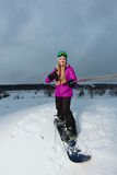 Young snowboarder shooting a selfie by her action camera Royalty Free Stock Photos
