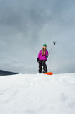 Young snowboarder shooting a selfie by her cell phone Stock Image