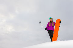 Young snowboarder shooting a selfie by her cell phone Stock Photography
