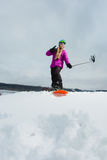 Young snowboarder shooting a selfie by her cell phone Stock Images