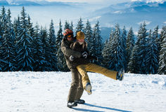 Young snowboarders fooling around royalty free stock photos