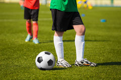 Young soccer football player. Standing on the soccer field Stock Photo