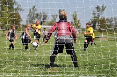 Young Soccer Goalie thru Netting. Young Soccer Goalie from Behind Goal Netting Royalty Free Stock Photos
