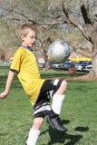 Young Soccer Player. Bouncing Ball stock photos