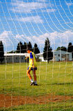 Young soccer player. Soccer player back from training stock photos