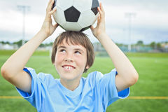 Young soccer player with ball on the field Stock Photos