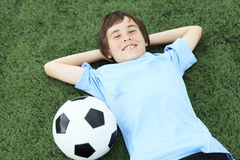 A young soccer player with ball on the field Stock Images