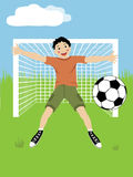 Young soccer player. Catches a ball Stock Photo