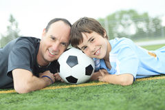 A young soccer player with father Stock Photo