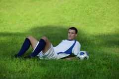 Young soccer player on green grass Stock Photography
