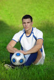 Young soccer player on green grass Stock Photo