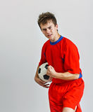 Young soccer player holding a ball Stock Photography