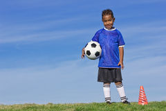 Young Soccer Player holding a ball Stock Image