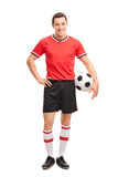 Young soccer player holding a ball and posing Royalty Free Stock Photography