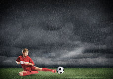 Young soccer player stock photography